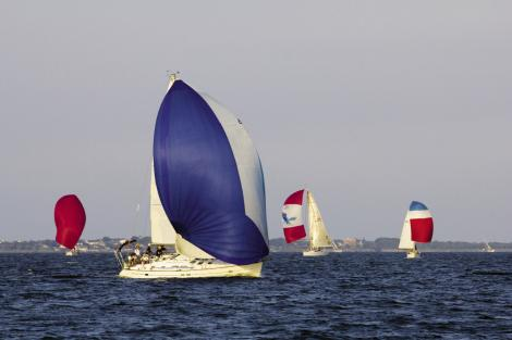 The fleet depends on colorful spinnakers for speed when they are sailing with the wind 90 degrees or more off the bow.