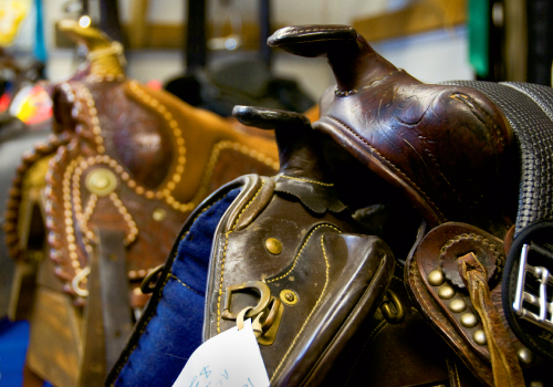 Rooms are piled high with country-Western wear as well as saddles, tack, and rodeo equipment.