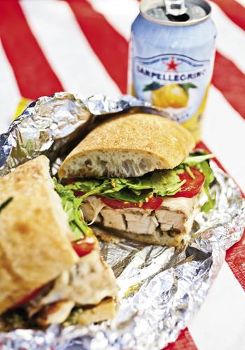 a savory chicken cutlet sandwich complete with Sanpelligrino Aranciata Italian soda