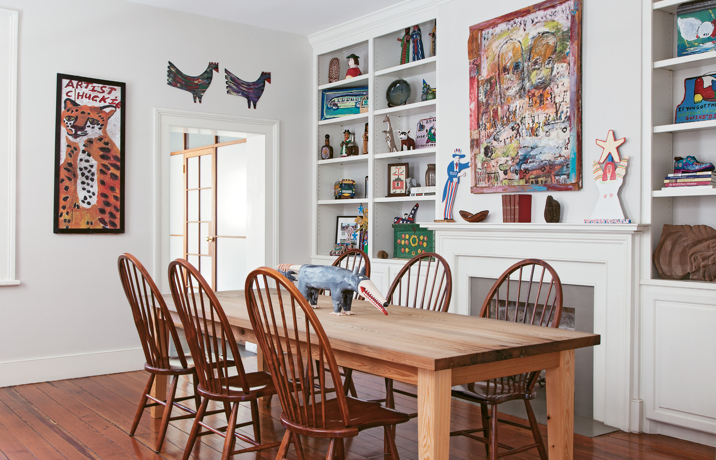 In the gallery-like dining room, built-ins display sculptures and smaller works