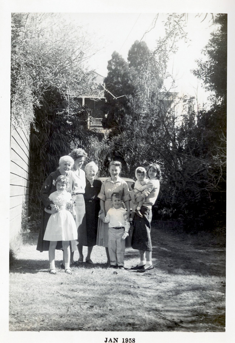 Harry McInvaill's mother, Eva Maye, with Caroline, Harry, and Alice in the garden