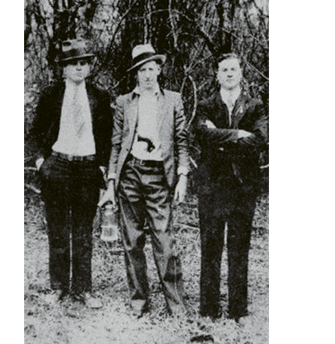 "(Left to right)  Al Capone, David Shuler, and an unknown man in Hell Hole Swamp; ""Mr. Shuler ran a mercantile store in Jamestown. This photo hung in his store until it closed,"" says Jamestown resident Douglas Guerry."