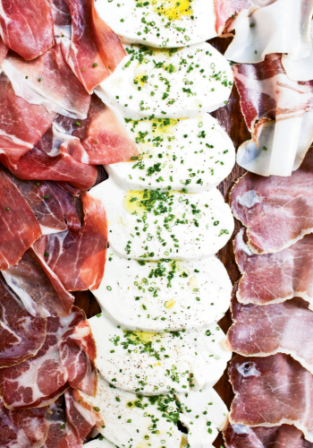 Slice of Heaven: Served with cured meats, mozzarella gets a lift with a sprinkling of chives, black pepper, sea salt, and extra-virgin olive oil.