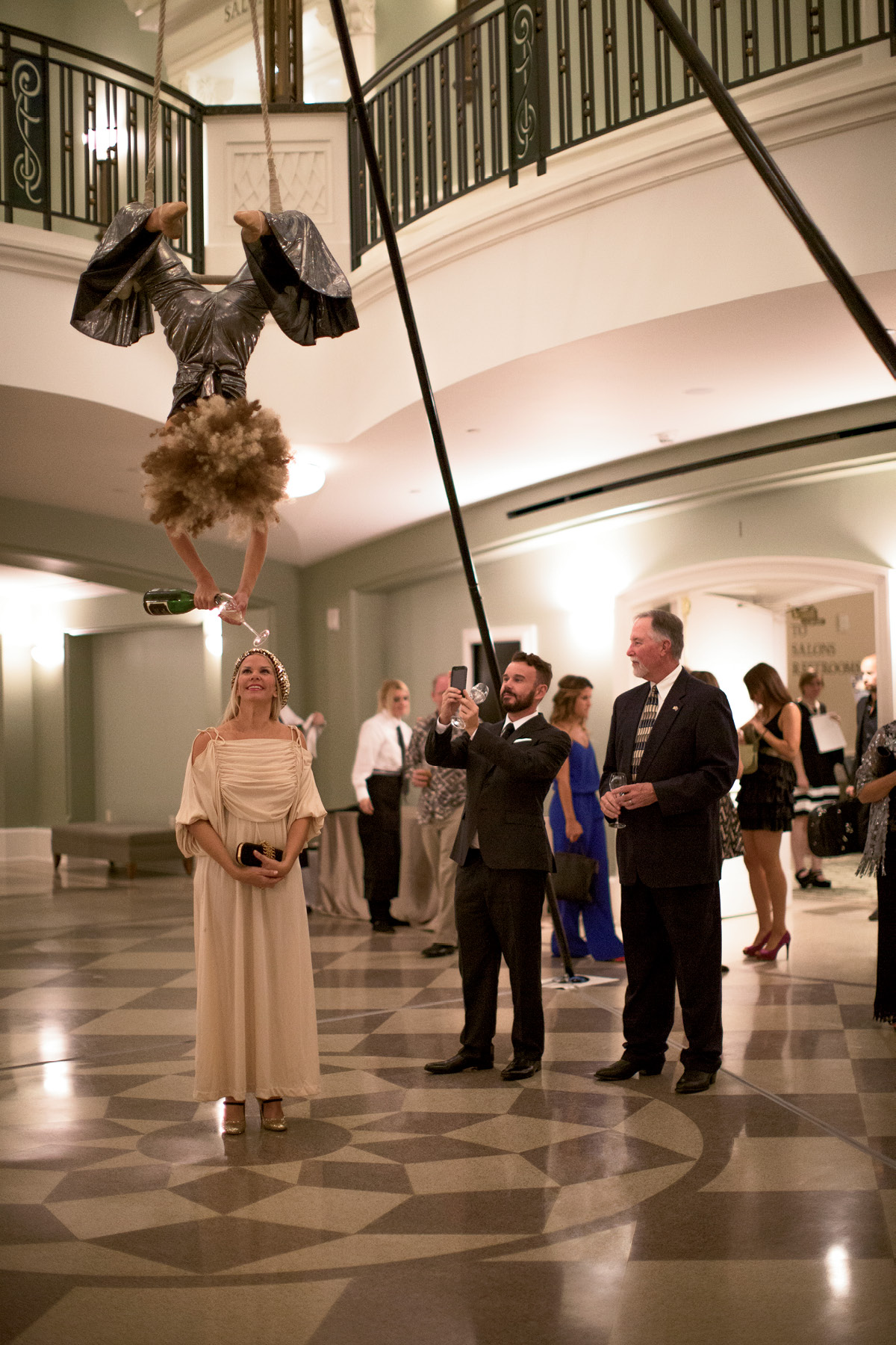An aerialist bartender from Elevate poured Biltmore Estate bubbles from above as guests entered the Grand Foyer