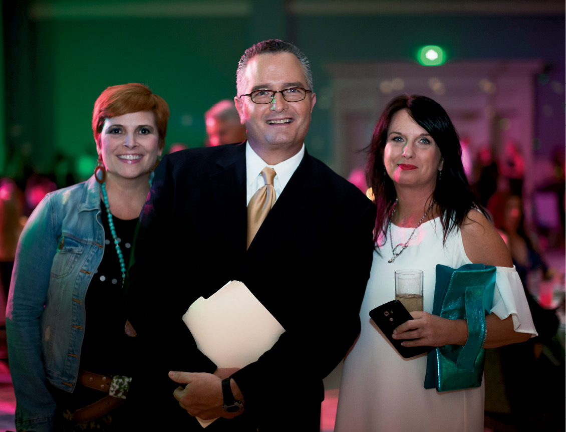 ABC News 4 anchor Dean Stephens, the evening's emcee,  with two fans. Photo by Jonathan Balliet
