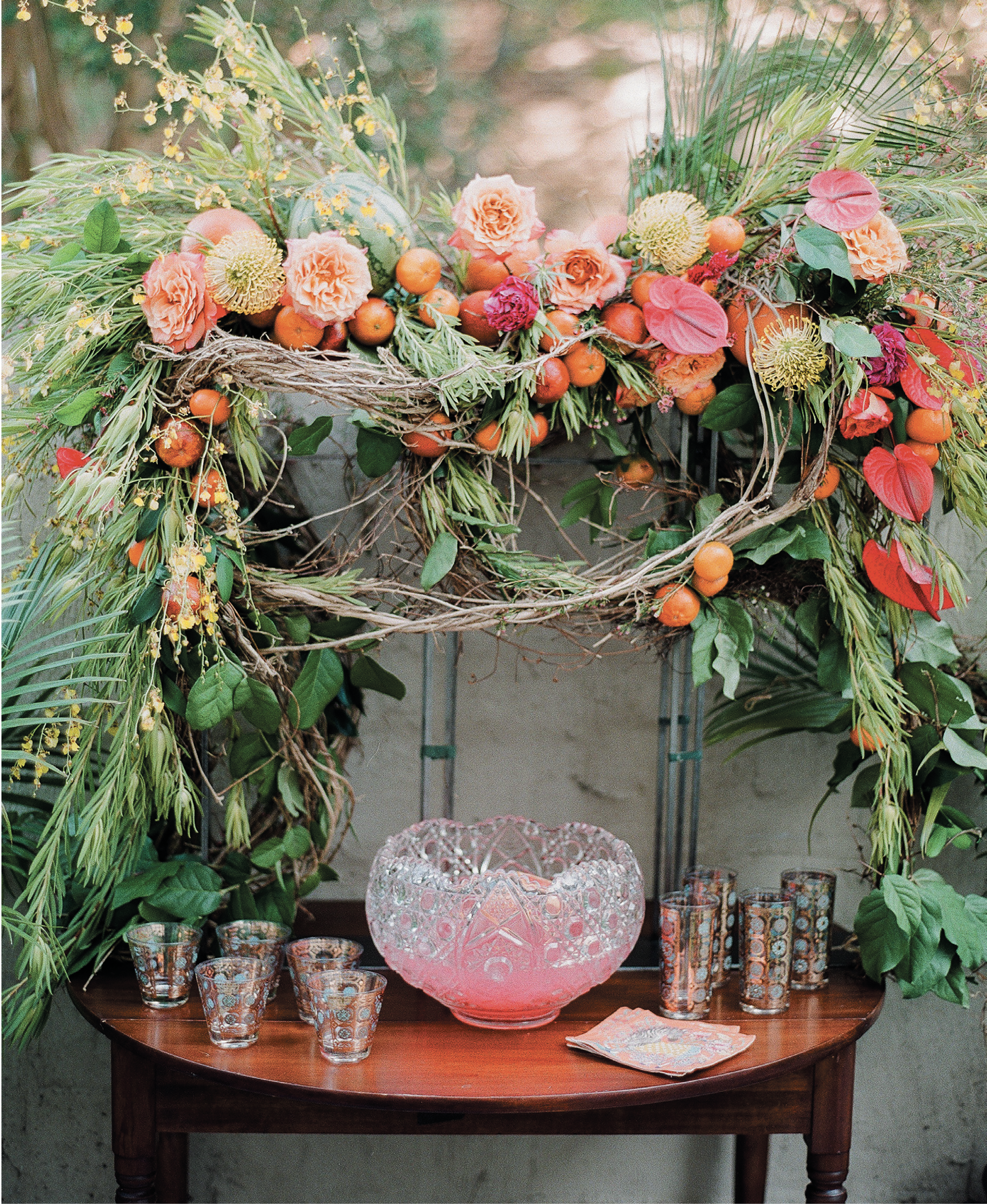 Wimberly Fair created the wow-factor floral and fruit arbor surrounding the punch table.