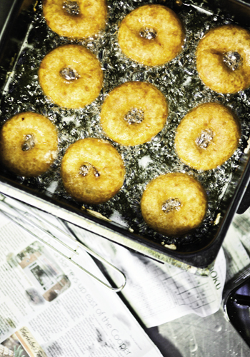 A batch of hot-out-of-the-oil vegan doughnuts