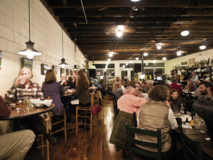 Tables fill quickly on Saturday nights for the live music, dinner, and pie at the Café at Williams Hardware in Travelers Rest.