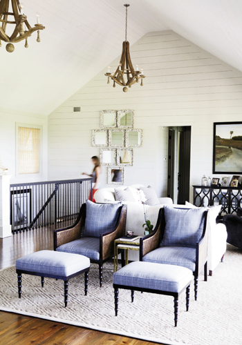 Room With Views: White shiplap creates a blank canvas to highlight intriguing shapes and textures, like handsome recovered furniture, show-stealing chandeliers, oyster-shell mirrors—even the ebb and flow of the Atlantic right outside.