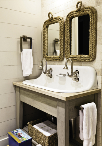 Jack-and-Jill bath with a vintage-style hanging wall sink.