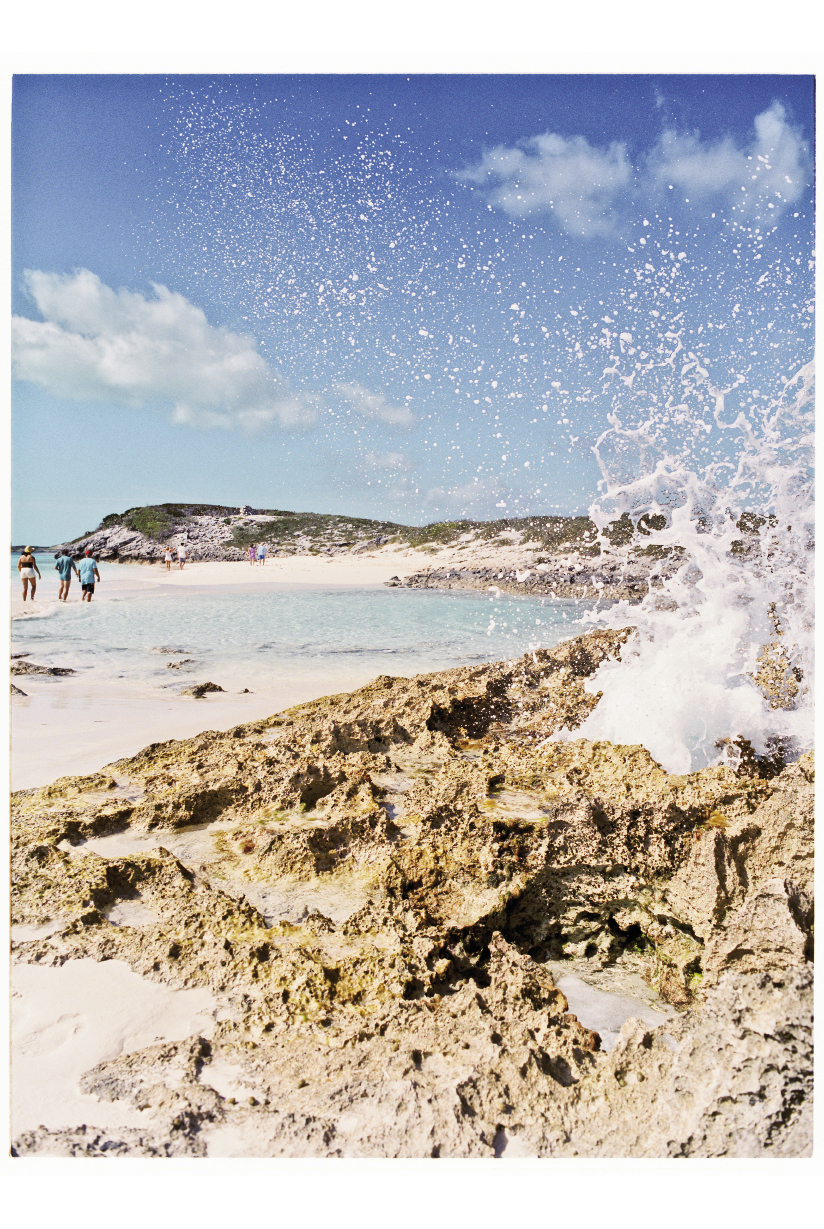 Sea spray whooshing from a coral formation near the Tropic of Cancer