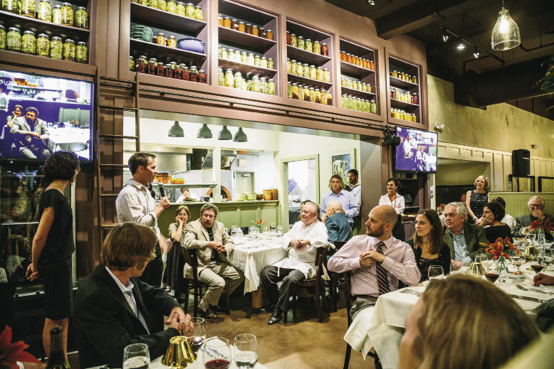 "California-based winemaker Patrick Saboe tells his Frank Lee stories to the night's crowd. Patrick, a waiter at the Colony House in 1991 when Lee joined Dick Elliott and David Marconi there as chef, helped open SNOB in '93 and, as Lee says, ""was part of the 'Gang of Four' waiters that ruled the floor."""