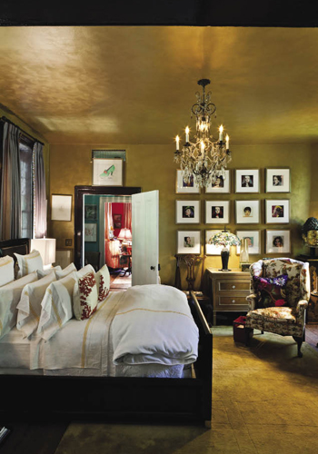 The master suite is ready for its close-up thanks to a top-to-bottom, golden-hued palette inspired by the 17th-century gilt bust of Kwan Yin, the Chinese goddess of mercy, and garnished with Andy Warhol's portraits of celebrities, including Marlene Dietrich, Liza Minelli, and Joan Crawford. Hanging next to the doorway is a drawing by Swiss artist Alberto Giacometti.