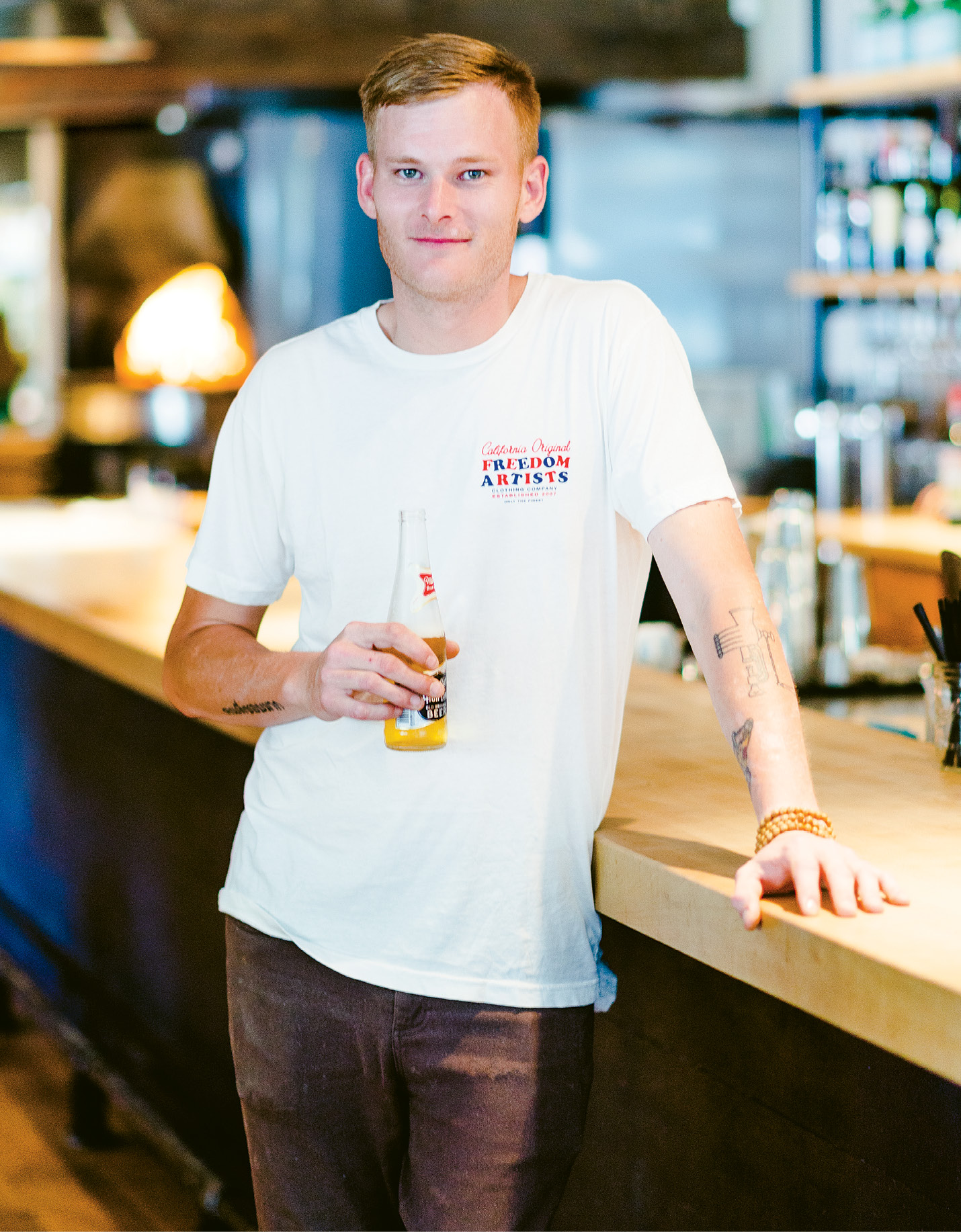 "Getzewich by the bar at Indaco with his favorite beer; ""I'll make you spaghetti and meatballs—it's not my job to say 'no.' But I like guiding diners to trying something they've never had."""