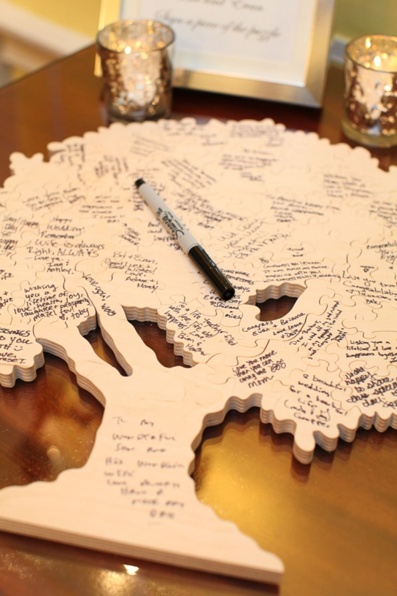 PICTURE THIS: Guests wrote their well wishes and signatures on an oak tree-shaped puzzle.