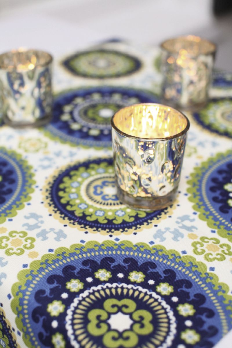 THERE'S NO PLACE LIKE HOME: Fashioned into table toppers at the reception, the fabric gave a fresh, modern look to the décor, which mimicked that of the couple's home.