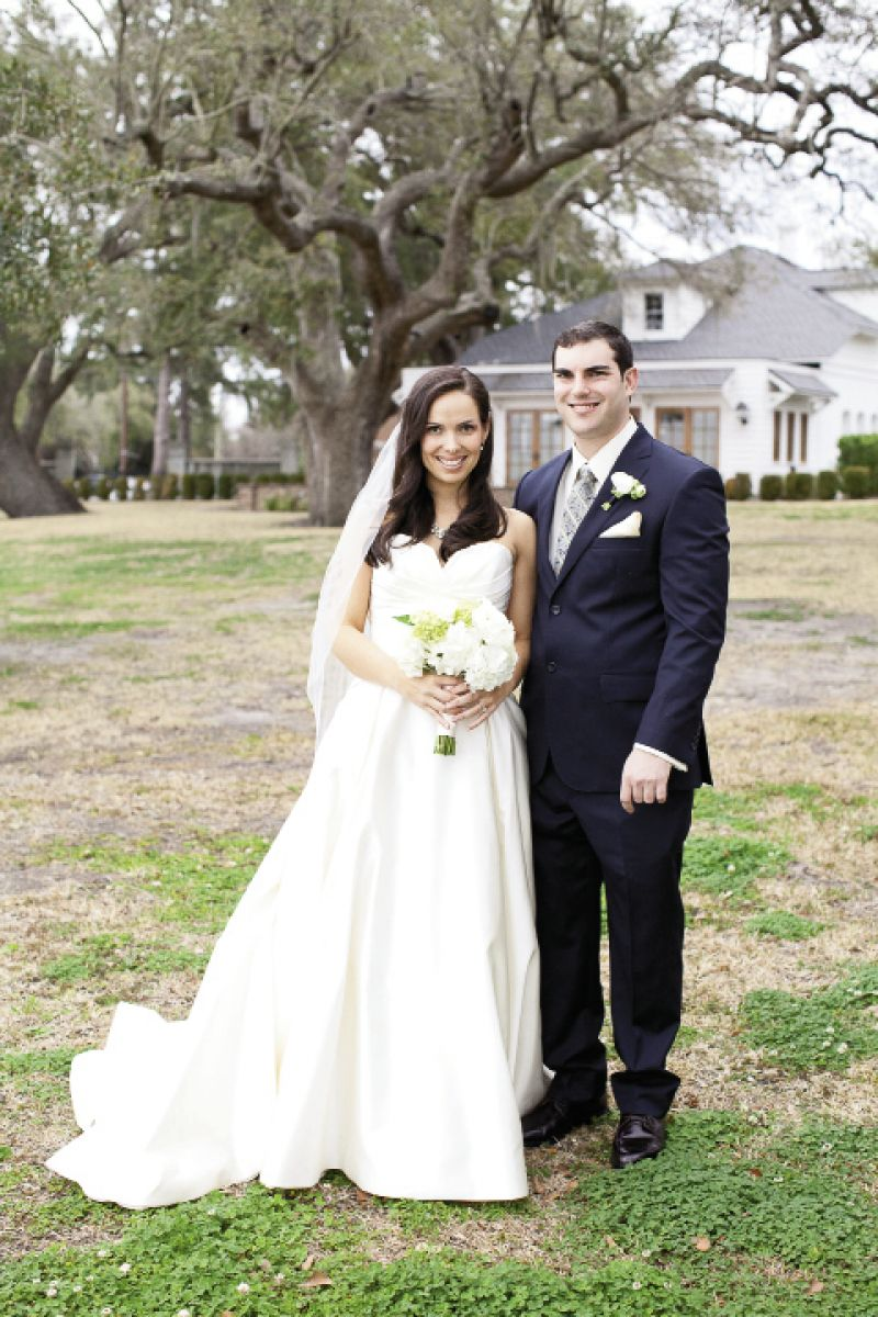 PICTURE PERFECT: While Brianna's Modern Trousseau gown was a testament to elegant simplicity, Evan's tie added pattern (and the wedding's palette) to his Oleg Cassini suit.
