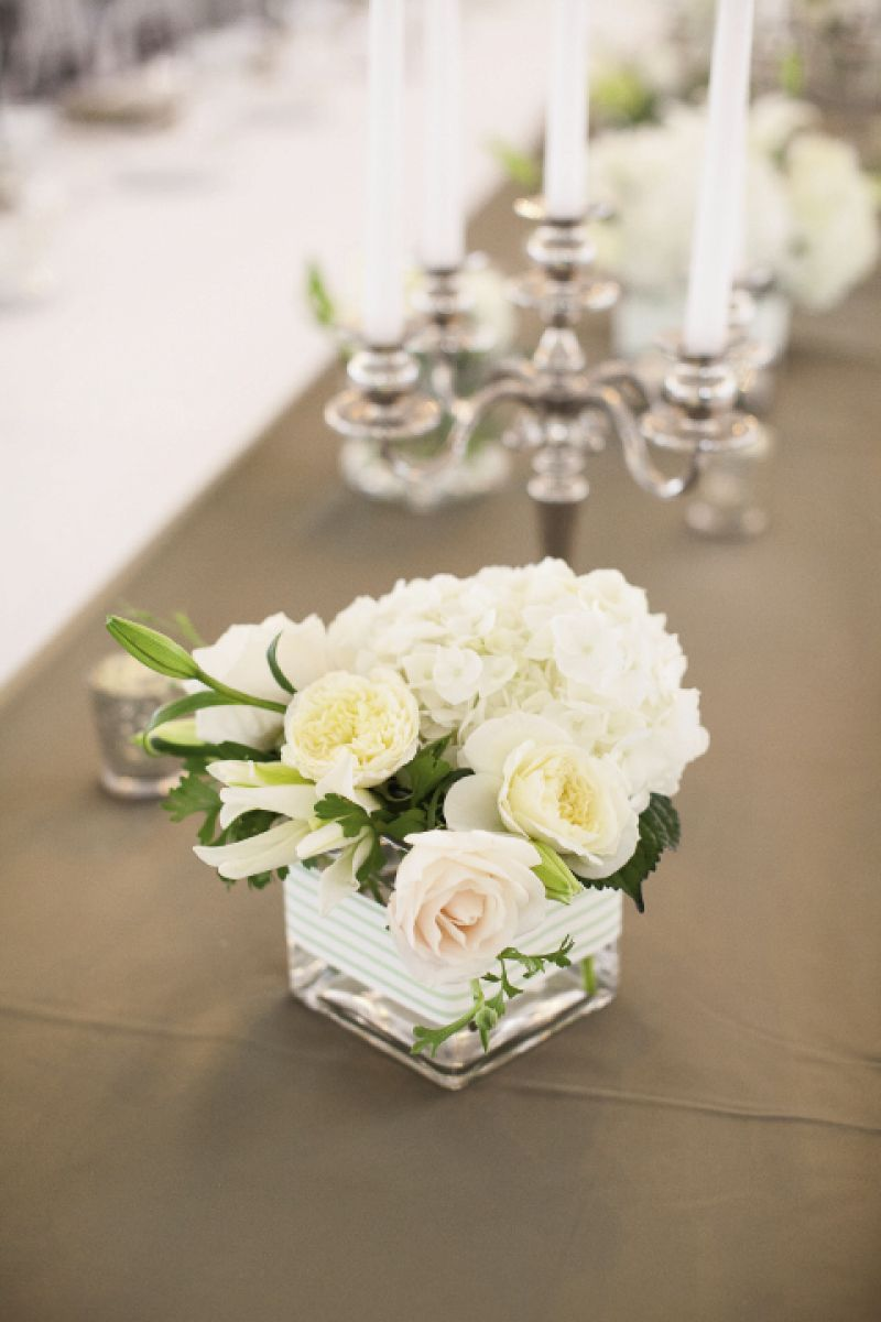 EARN THOSE STRIPES: The stripes on the couple's stationery suite also accented vessels with blooms from Jade Water Designs.
