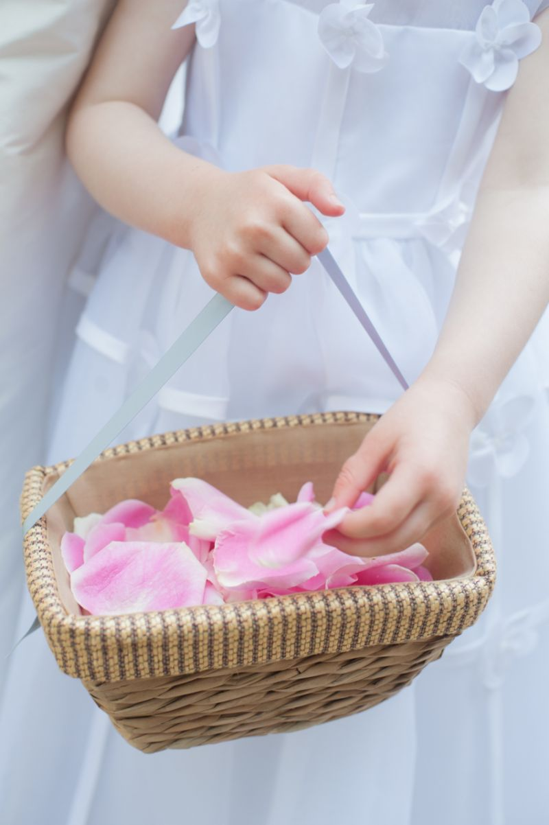 SPECIAL SPRINKLES: The flower girl paved the way for the bride using pink rose petals.
