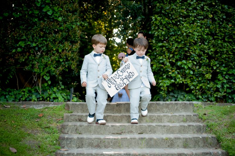 PRECIOUS PAIR: Suited up in seersucker and bow ties, ring bearers Keenan Ward (left) and Liam Green introduce their aunt D'Anne.
