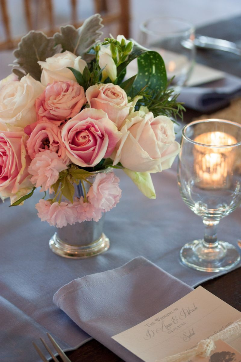 POSY PERFECT: For reception tablescapes, stems placed roses, carnations, and Lamb's Ear into silver vessels.