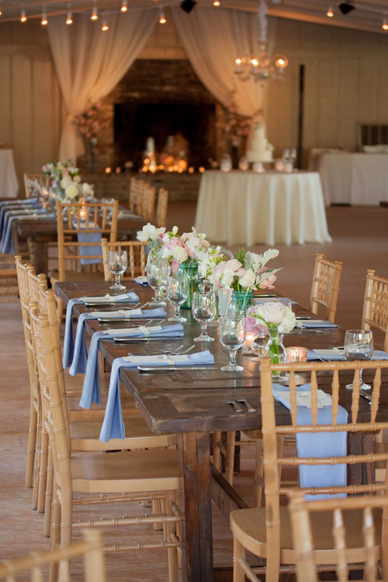 YOUR TABLE AWAITS: White, pink, and green arrangements and baby blue linens from BBJ Linens softened the rustic charm of the reception's wood-finished Chiavari chairs and wooden tables from Event DRS.