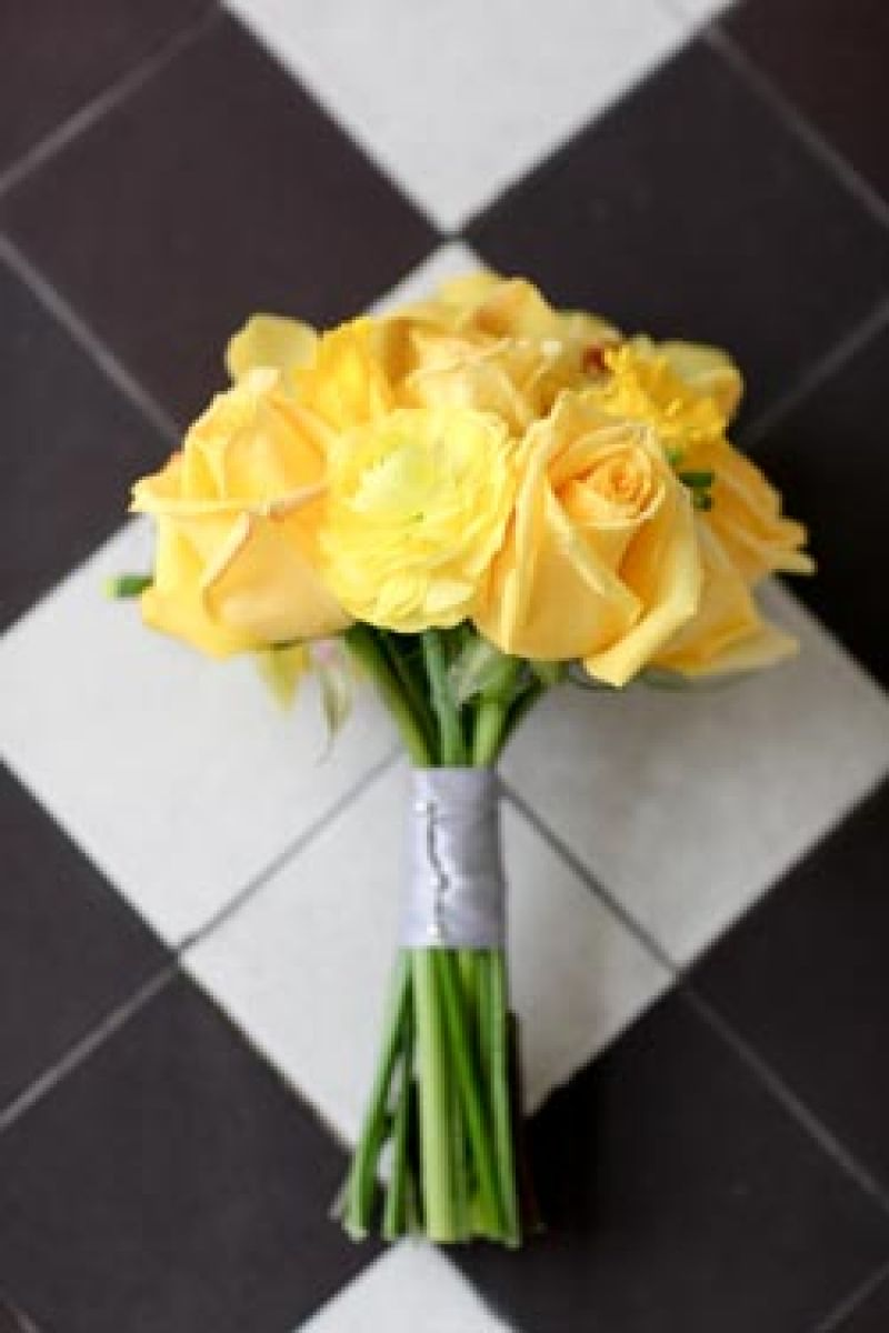 COLOR ME HAPPY: Accented with gray ribbon and pearl-tipped pins, the bright yellow bridesmaid bouquet stood out with a classic style that evoke a vintage palette.