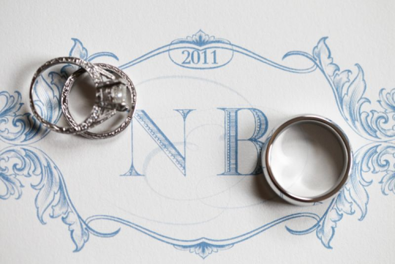 "WITH THIS RING: Scotti Cline created the wedding monogram, which the couple used as an accent on the invitations and cake. One of Nikki's favorite touches? ""My favorite part of the lighting in the tent was our custom-made monogram spotlight that shown on the black-and-white-checkered dance floor."""