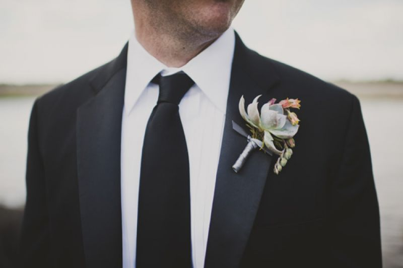 DAPER DECORATION: Jason's boutonniere, a succulent fashioned by A Charleston Bride, popped against his classic J. Crew tuxedo.