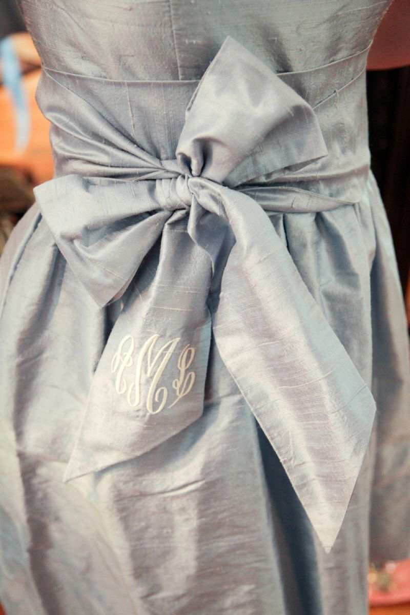 PERSONAL TOUCH: Each attendant's initials were embroidered in the sash of their LulaKate frocks.
