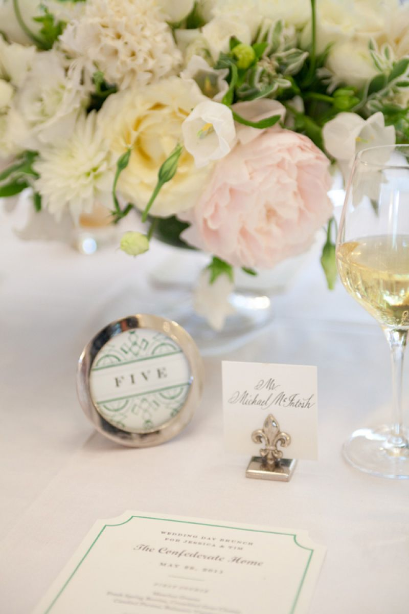ALL SET!: Table numbers and brunch menus, which were crafted by Quarter Century Creative, matched the couple's invitation suite, while silver accents added a classic touch.