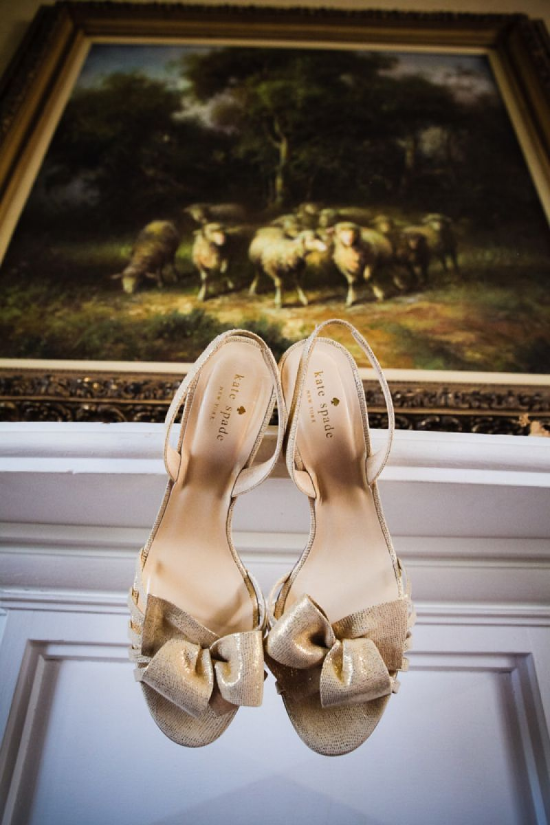 "HEART AND SOLES: For the ceremony, Carrie wore gold Kate Spade heels from Copper Penny. Self-admittedly not much of a heels girl, she changed into a pair of London Sole ballet flats for the reception. ""I was happy to give my feet a reprieve and boogie the night away in cute flats!"" says the bride."