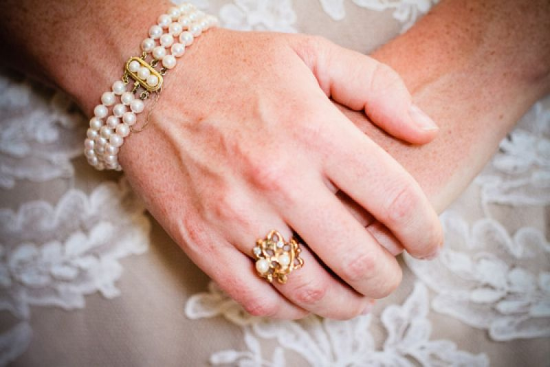 "THE PERFECT TOUCH: Jewelry from her stepmother's side of the family fit the bill for the bride's ""something borrowed."" Carrie says she loved how the pieces fit in with the evening's vintage vibe."