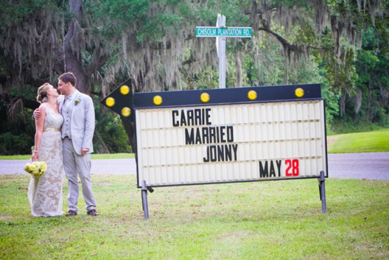 OPENING SHOW: Carrie and Jonny rented an old movie sign to direct guests to the wedding and played off of the name of their wedding website: CarrieMarriesJonny.com.