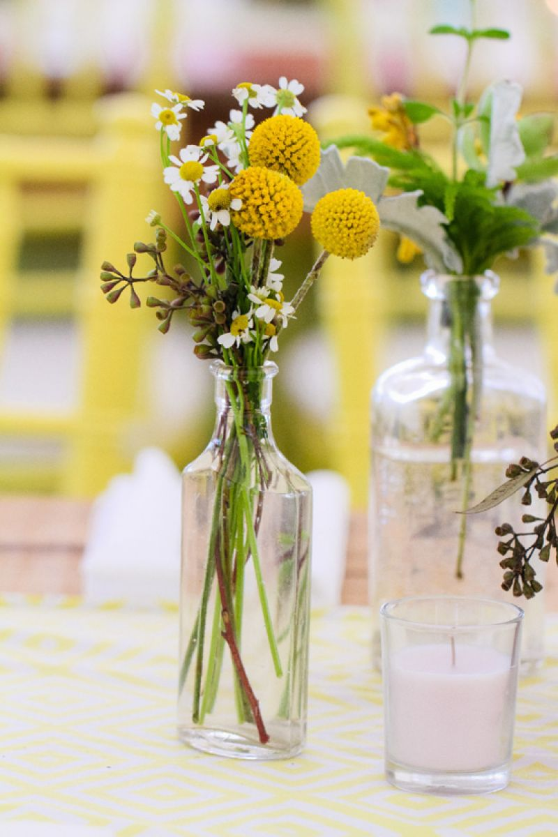 SIMPLE SOLUTIONS: Clear tincture bottles held Billy Balls, daisies, and lamb's ears.