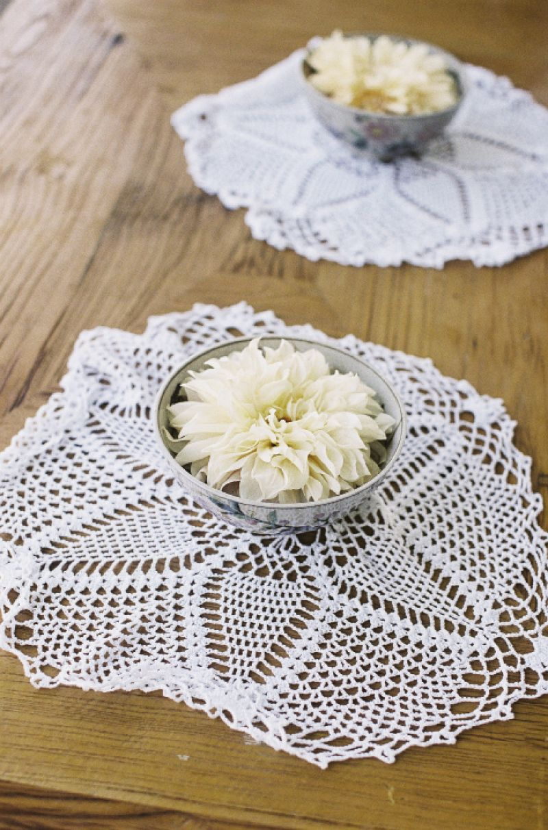 NICE TOUCH: Dinner plate dahlias floated in silver bowls that were placed atop doilies.