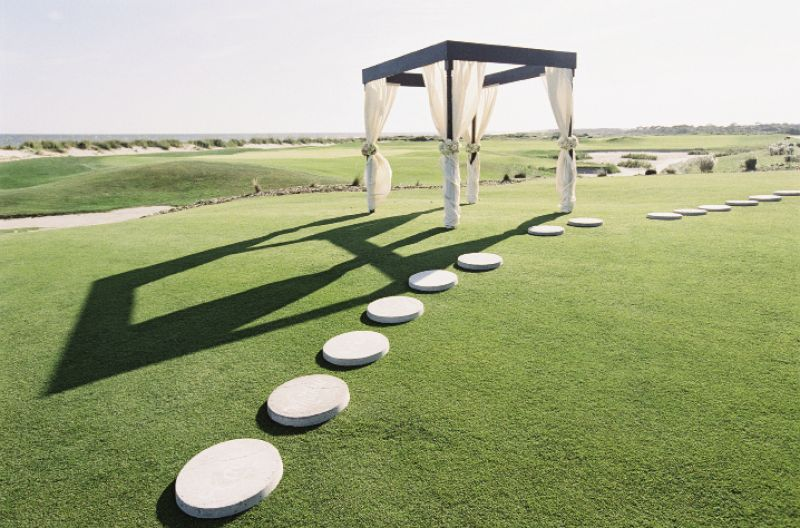 LANDSCAPING 101: The Soirée team constructed a draped canopy and arranged an arc of garden stepping stones where the bridesmaids and groomsmen stood during the ceremony.