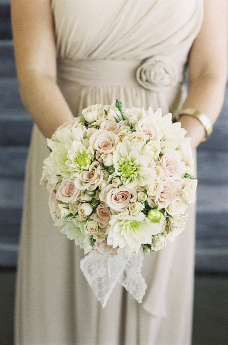 SWEET AND SIMPLE: Soirée's full-bodied bouquets blended ivory and soft pink dahlias, garden roses, and spray roses.