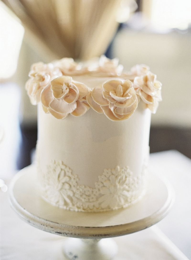 INSPIRED TASTE: In addition to the couple's stationery, Crystal's lace veil inspired the designs on Jim Smeal's cakes.
