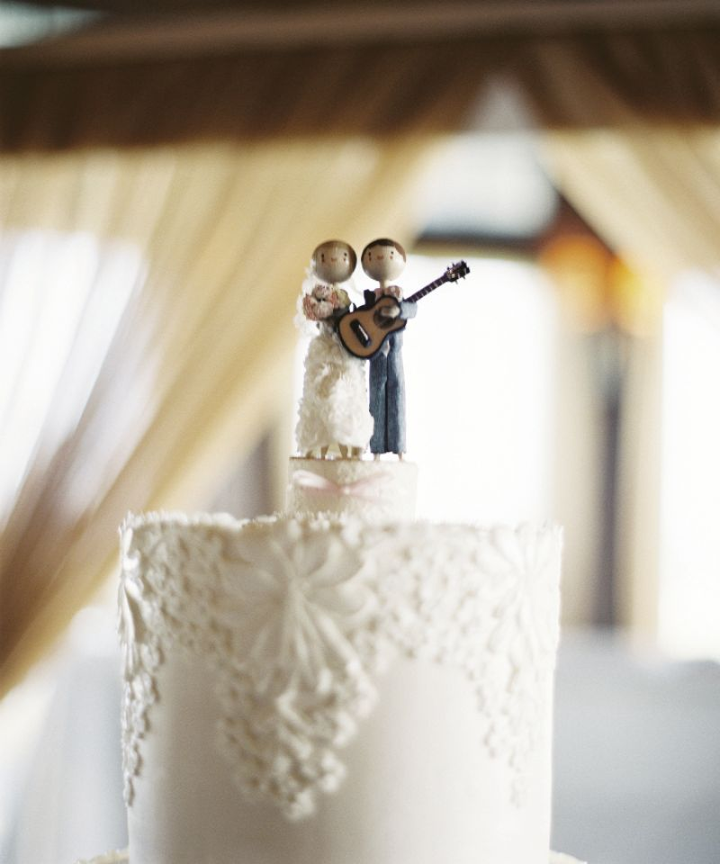 "MUSIC MAN: Crystal's advice for brides-to-be? ""Add personal touches to make your wedding special and unique to you."" For her part, Crystal commissioned this cake topper (the figurines were dressed like the bride and groom) from TheSmallObject.com. The guitar is an ode to the groom's love of music--Matt rocked Charleston for 10 years as the lead singer and guitarist of Milhouse."
