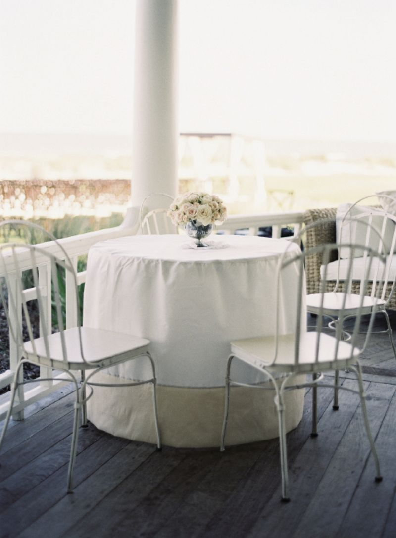 SEASONAL CHOICE: Delicate white chairs and linens were perfect for the warm-weather wedding.