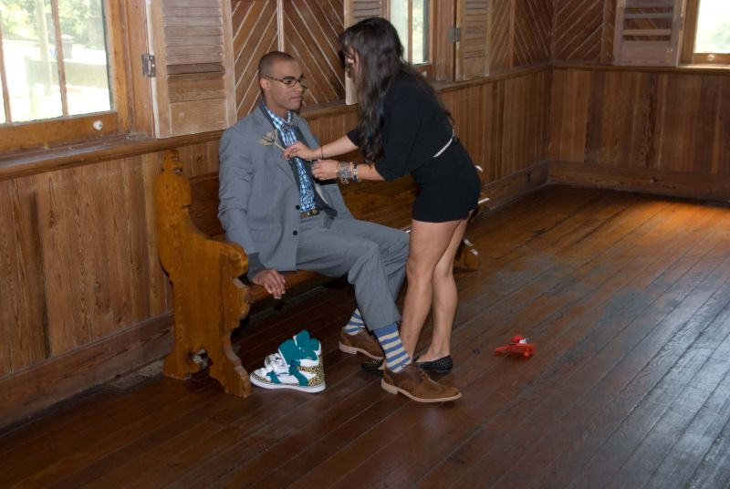 Style assistant Angelica Diaz tries to sort out which side a boutonniere should be pinned on.