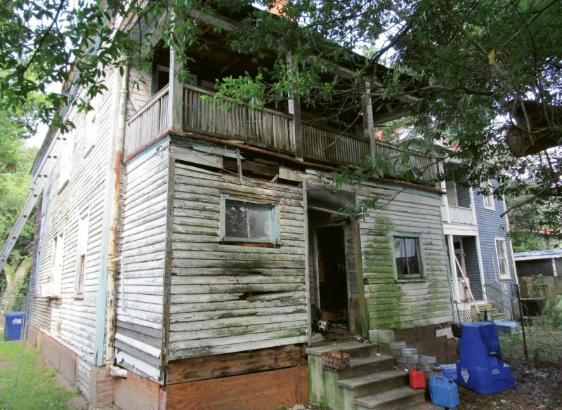 Before: During the renovation, the rotting back porch that had been closed in at some point was removed from the rear facade.
