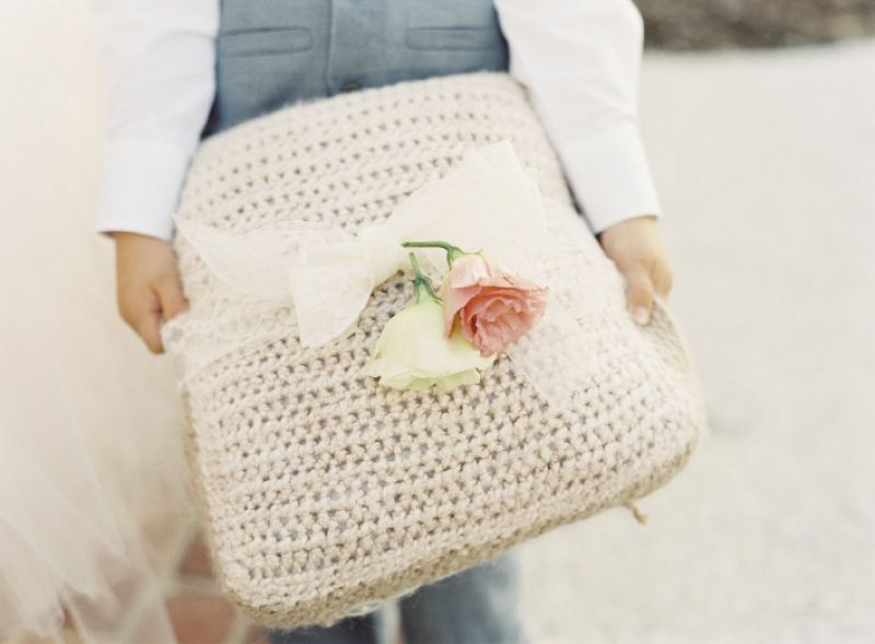 PILLOW TALK: Crystal crocheted the cover for the ring bearer's cushion and tied a pair of roses on top with sheer ribbon.