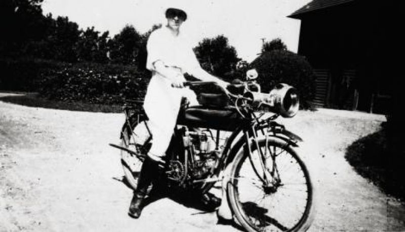Belle rides a motorcycle at the family's rented summer estate in 1915