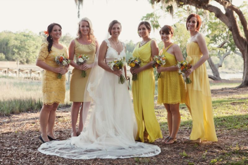 SUNNY SHADES: Bridesmaids wore different styles of yellow dresses, a bold yet cheery complement to Lindsey's vintage-styled gown