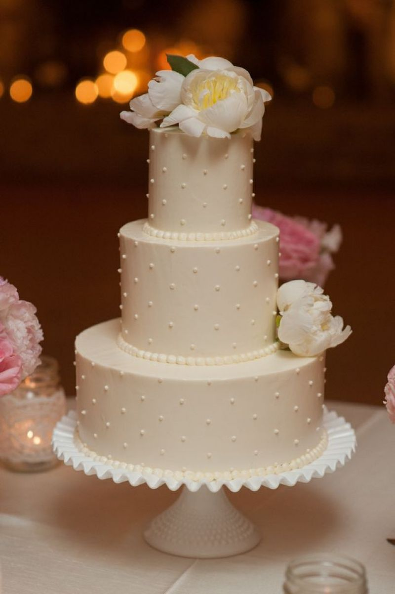 SWEET & SIMPLY: The Cake Stand's triple-tiered cake was decorated with Swiss dots and garnished with two pale peonies.
