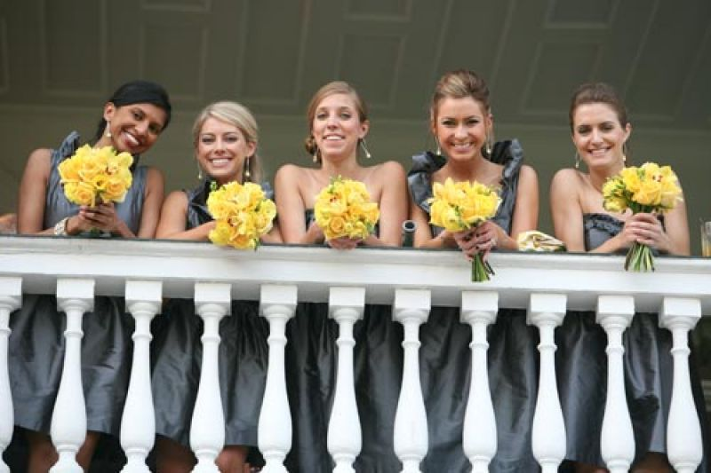 GOLDEN GIRLS: Yellow bouquets popped against the bridesmaids' gray frocks from LulaKate.