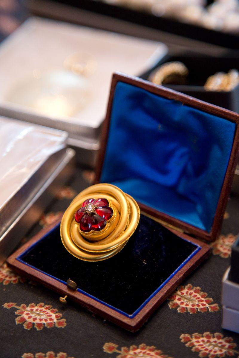 Garnet, diamond, and gold estate brooch from Croghan's Jewel Box; photo by Mac Kilduff