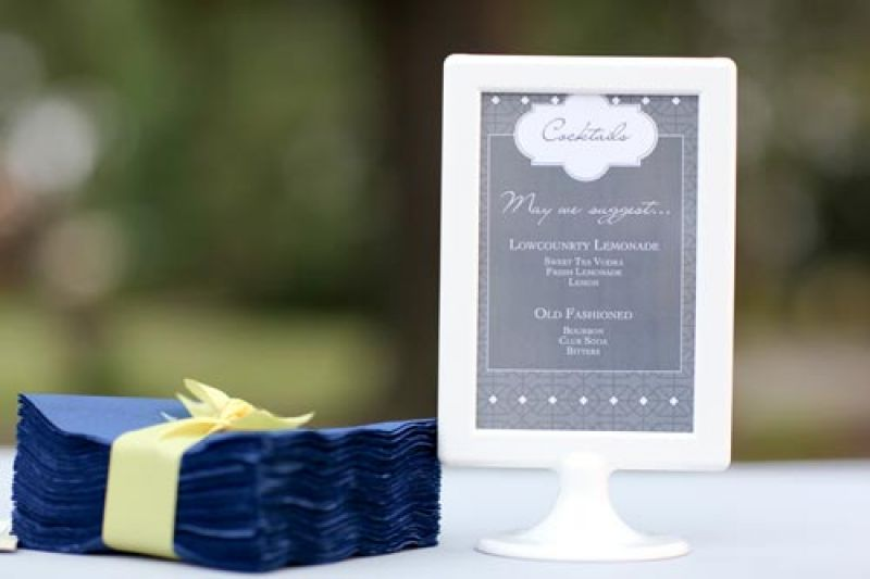 HAPPY HOUR: Though shades of yellow and gray dominated the color palette, hints of blue were splashed throughout the reception décor and stationery suite.